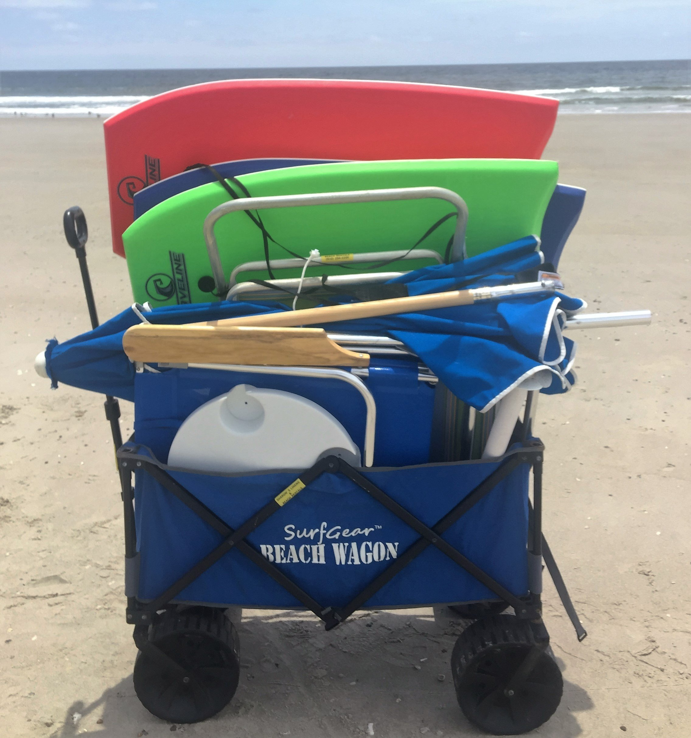 An image of the Beach Wagon carrying umbrellas, beach chairs and boogie boards